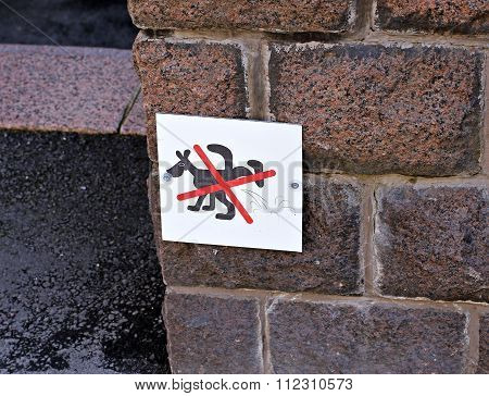 A Sign On The Wall, Which Means That Banned Dogs Urinate In Helsinki