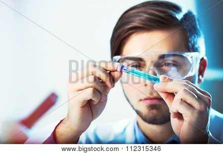 Young medical technician working in laboratory