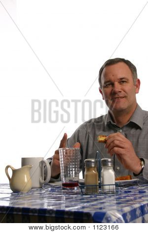 Man Enjoying Meal At Diner