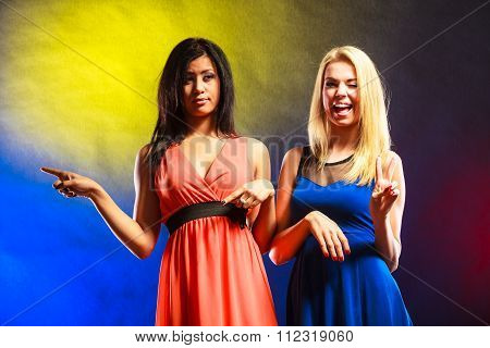 Two Funny Women Showing Something