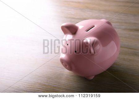 Pig moneybox on wooden background