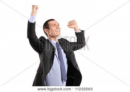 Portrait Of A Young Happy Businessman With Raised Hands