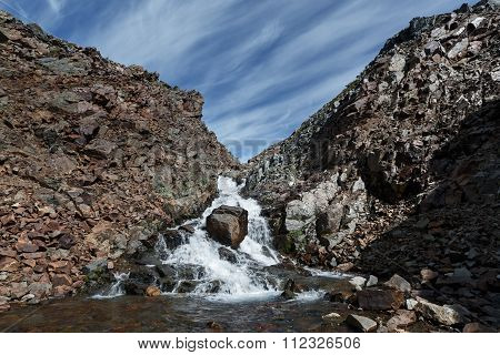 Picturesque Summer Landscape: View Of Beauty Mountain River Into The Steep Cliffs