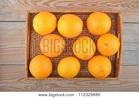Orange On Wickered Tray