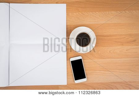 Blank Newspaper with empty space and coffee cup, mobile phone mock up on wood background