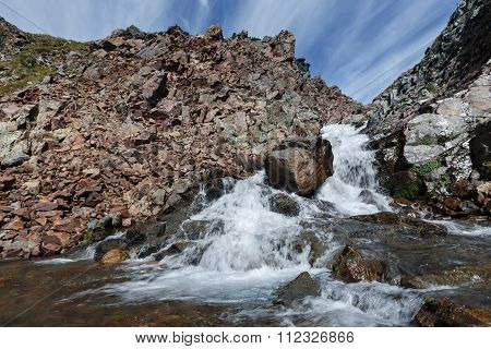 Beautiful Summer Landscape: View Of Picturesque Mountain River Into The Steep Cliffs