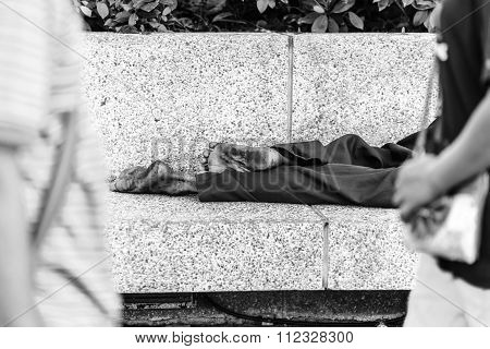 Homeless People Sleeping At Streetside In City, Black And White.