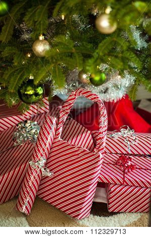 Close-up image of a Christmas presents placed under Christmas three