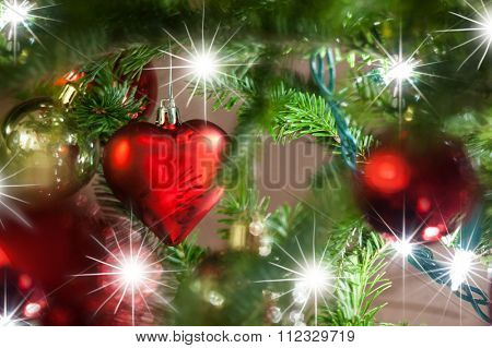 Christmas ornament in heart shape hung on a Christmas tree