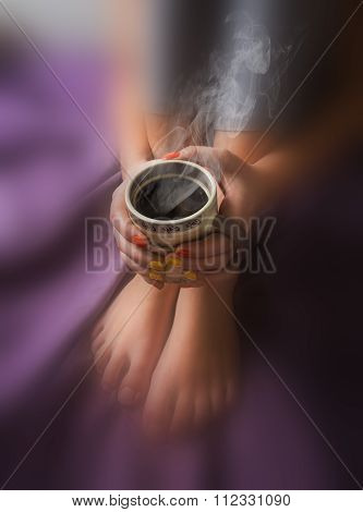 Legs Of Girl In Warm Woolen Socks And A Cup Of Coffee Warming