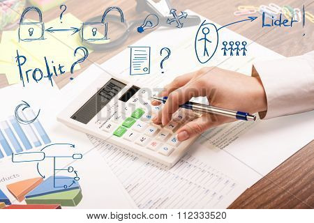 Young business woman inspecting invoice