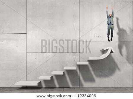 Businessman with suitcase jumping up stone staircase
