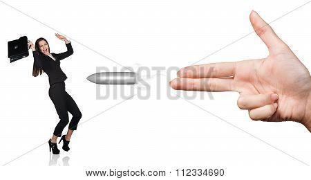 Woman hand showing gun gestureand shot
