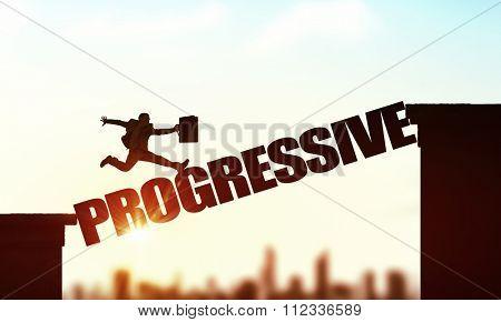 Businessman running on progressive word bridge over precipice