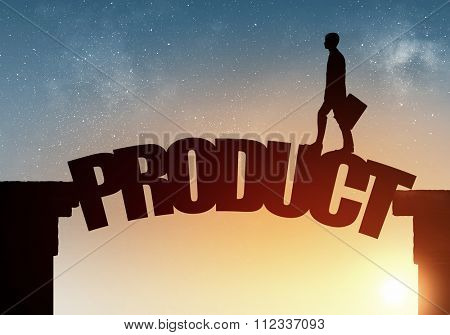 Businessman running on product word bridge over precipice