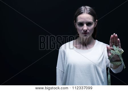 Bulimic Girl On Black Background