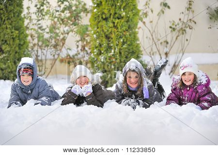 Children Laying On snow