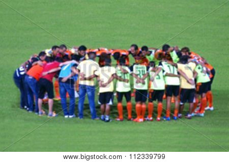 Blur Image Of Thai Soccer Players And Staff Coach