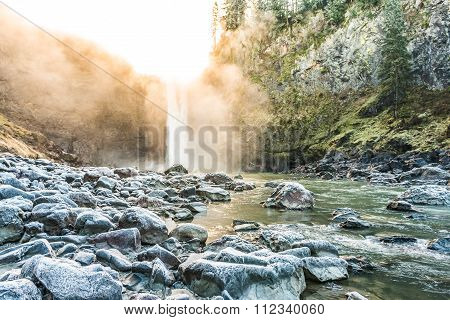 Scenic View Of Snoqualmie Falls With Golden Fog When Sunrise In Winter Season