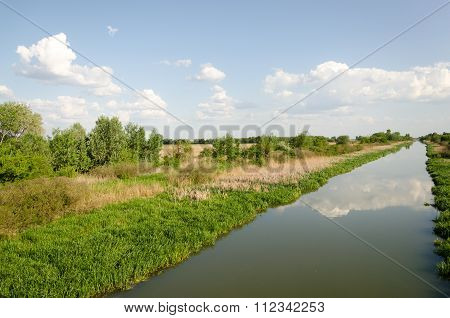 East-Main Canal at Tiszavasvari, Hungary. It is one of the Canals of the Tisza river.