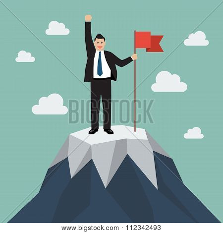 Businessman With Flag On A Mountain Peak