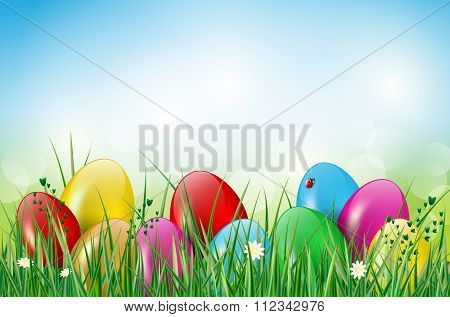 Happy Easter Background With Easter Eggs In Grass