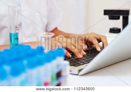 scientist typing