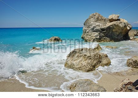 waves crashing on the rocks at Megali Petra Beach