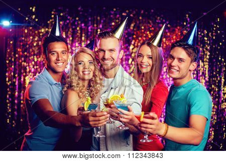Group of cheerful friends toasting at birthday party