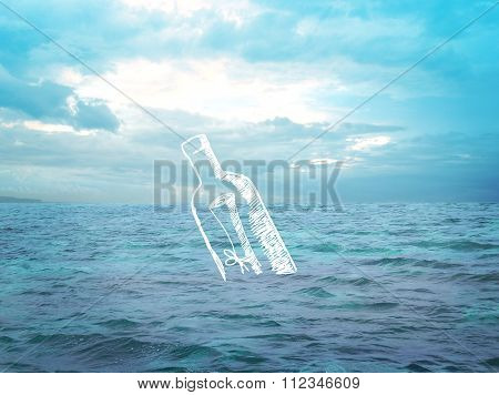 Bottle with a letter floating in the ocean