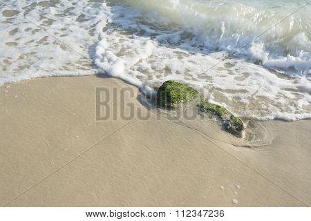 Waves Game On Stone At Beach