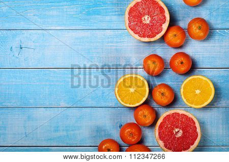 Fruit Background Closeup- Grapefruit, Apples, Oranges And Tangerines