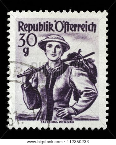 AUSTRIA - CIRCA 1950: A stamp printed in Austria shows image woman in national Austrian costumes, Salzburg, Pongau , from the series