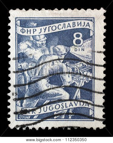 YUGOSLAVIA - CIRCA 1952: A stamp printed in Yugoslavia shows miners, domestic economy Series, circa 1952
