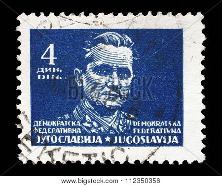 YUGOSLAVIA - CIRCA 1945: A stamp printed in Federal Democratic Republic of Yugoslavia shows Marshal Josip Broz Tito, circa 1945