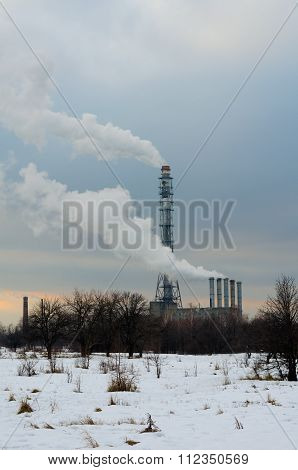 Smoking Chimneys Boiler On The Background Of Trees And Snow