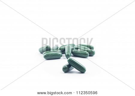 Green Capsule Pills On White Background