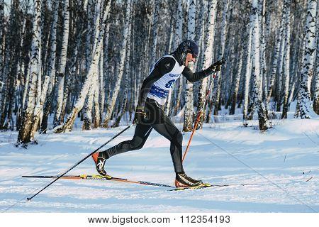 side view young skier athlete sprint race in classic style