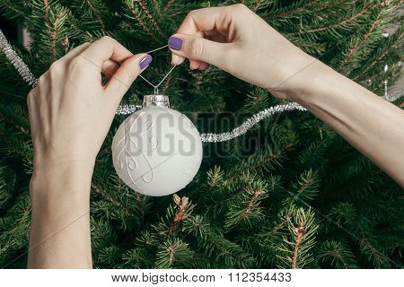 The Girl Decorates A Christmas Tree