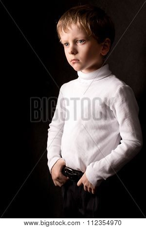 Portrait Of The Boy On A Black Background.