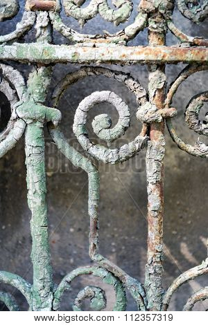 Old rusty forged fence, close up