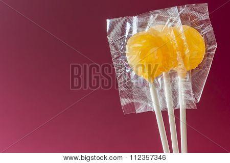 Three Lollipop Yellow Isolated Amaranth