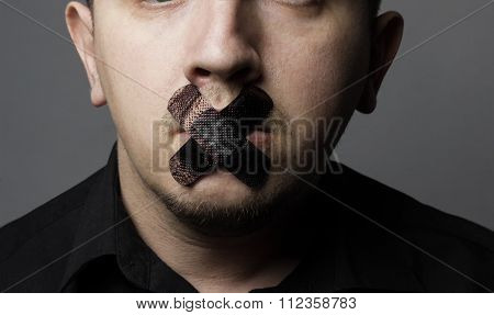 Man With Mouth Covered By Black Patch To Forbidden Him The Free Speeching