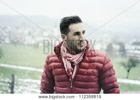 Attractive Young Man Looking Sideways And Enjoying The Scenery In Winter Season