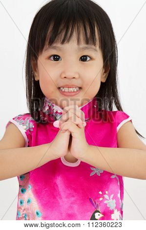 Chinese Little Girl Wearing Cheongsam With Greeting Gesture