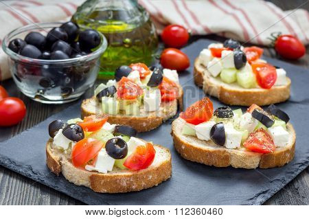 Greek Style Crostini With Feta Cheese, Tomatoes, Cucumber, Olives And Herbs