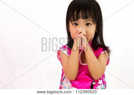 Chinese Little Girl Wearing Cheongsam Praying