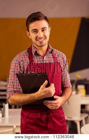 Happy Waiter During Work