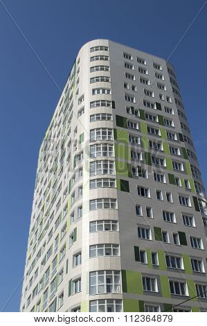 The New Inhabited Multi-storey Building Against A Clear Sky