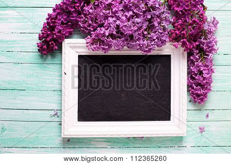 Background  With Fresh Lilac Flowers And Empty Blackboard  On Turquoise Painted Wooden Planks.